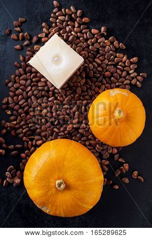 autumn composition with pumpkin and pine nuts. Top view