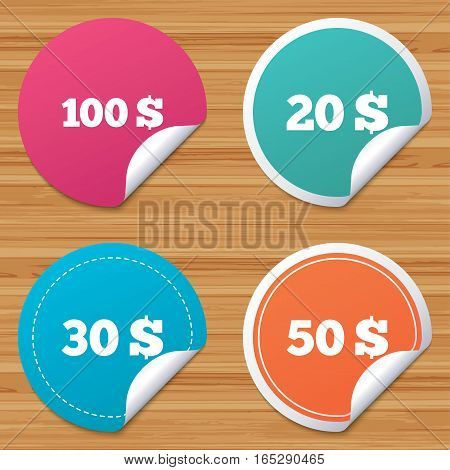 Round stickers or website banners. Money in Dollars icons. 100, 20, 30 and 50 USD symbols. Money signs Circle badges with bended corner. Vector