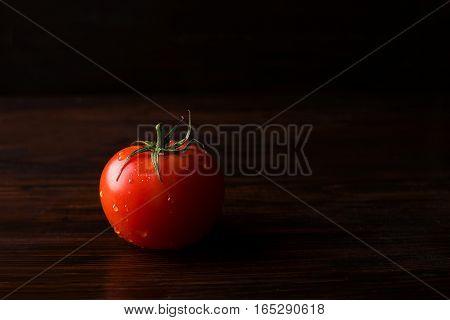 Tomato on a dark background. Tomato on a dark background. Tomatoes on a dark background.Healthy food concept