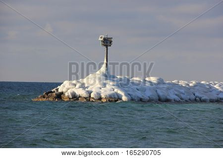 Ice and snow covered breakwater in Michigan
