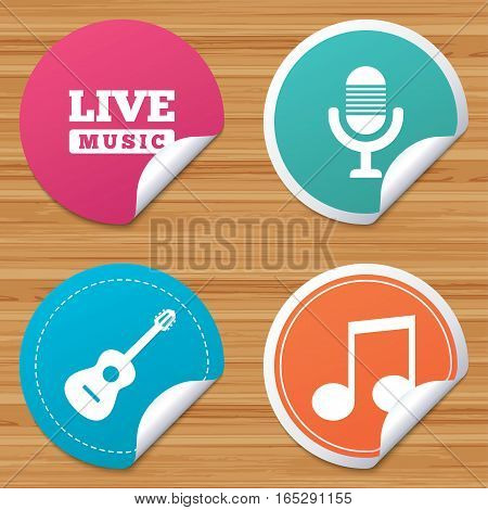 Round stickers or website banners. Musical elements icons. Microphone and Live music symbols. Music note and acoustic guitar signs. Circle badges with bended corner. Vector