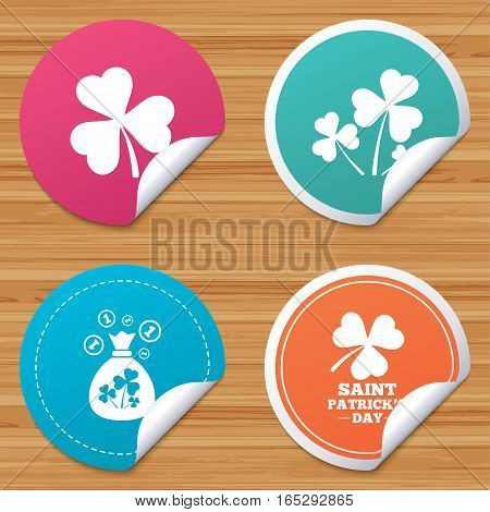 Round stickers or website banners. Saint Patrick day icons. Money bag with clover and coins sign. Trefoil shamrock clover. Symbol of good luck. Circle badges with bended corner. Vector