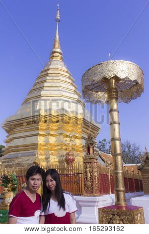 Asia man and woman at Wat Phra That Doi Suthep, Chiangmai Thailand