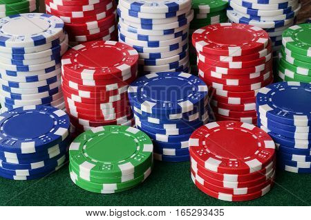 A close up image of stacked poker chips on a casino table.