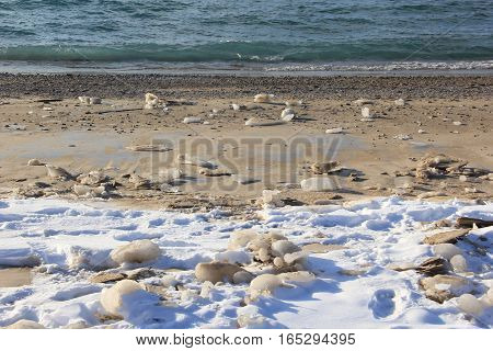 Lake Michigan waves on a frozen beach in Michigan