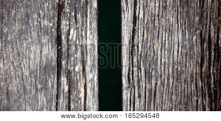 Wood pier abstract texture of a natural gray. View of old weathered deck wooden board. Vertical wood background texture.
