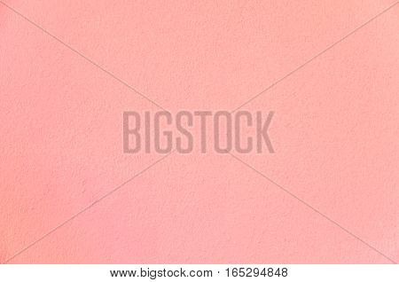 Pink grunge concrete wall texture background create from plaster cement material.