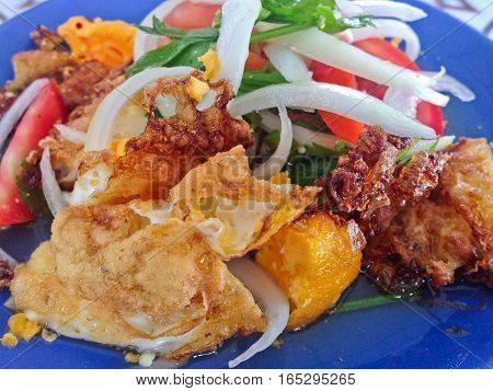 Spicy salad with fried eggs, Thai Spicy Food, Thai Cuisine, Healthy Thai Food