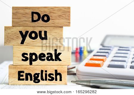 Text message Do you speak english on wooden with office table. Business concept