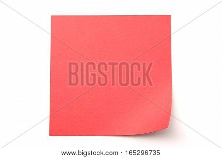Red stick note on a white background