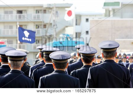 Attention Japanese police officers with japanese flag