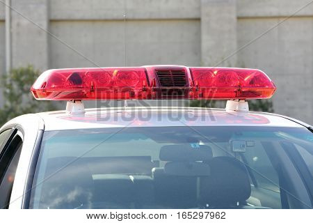 Roof mounted red lightbar of police car