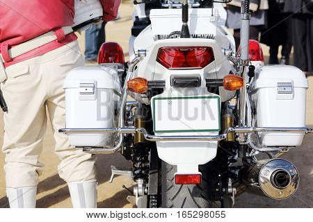 Back view of Japanese police motorcycle and police woman