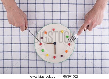 Lunch time concept clock in plate knife and fork