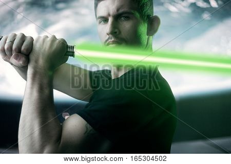 A Young Man With A Laser Sword On The Background Of Cosmic Scenery,