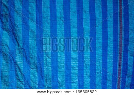 Old Blue Shading Net With Sun Light In Outdoor Market Texture And Background.