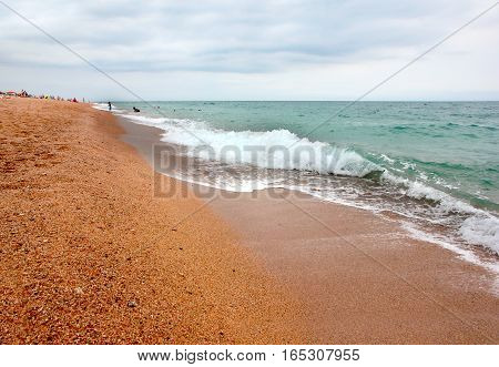 coastal zone of the Mediterranean sandy beach under a beautiful sunny sky