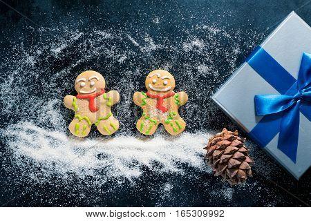 Baking Gingerbread Men For Christmas On Dark Table