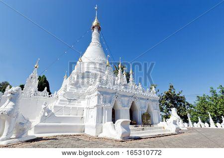 White Buddha Pagoda Temple In Wat Pra Tard Doi Kong Mu Temple With Clear Blue Sky In Thailand