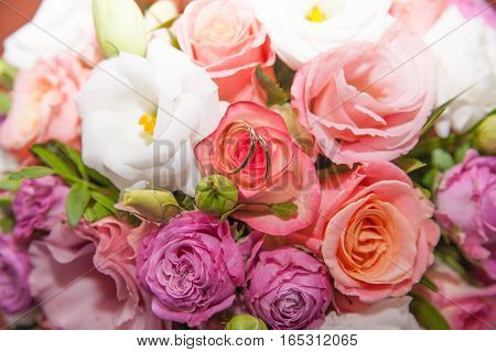 very beautiful wedding bouquet with gold rings