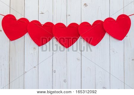 Red Heart Hanging On White Wood For Celebration With Space.