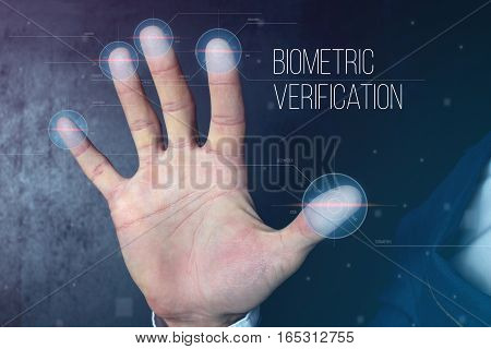 Man passing biometric identification with fingerprint scanner service of security and protection concept futuristic technology