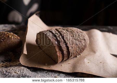 Man cuts bread. Background with bread. bread