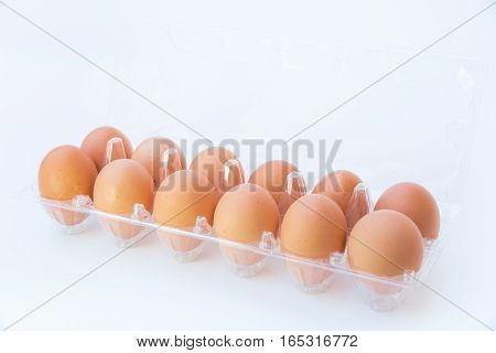 Chicken eggs in a plastic pack isolated on white background.