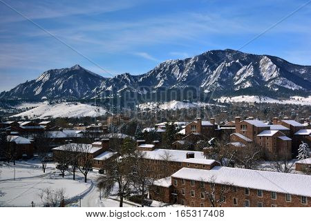 The University of Colorado Boulder Campus on a Snowy Winter Day with the Flatirons in the Background