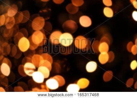 Abstract bokeh twinkled background with boke defocused golden lights - Festive blur background.