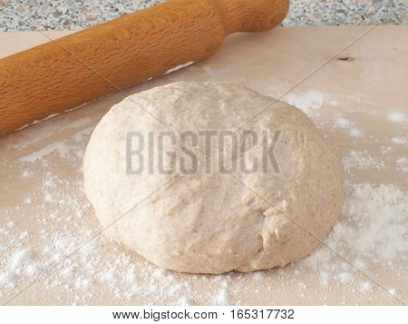 Cooking process. Preparing fresh dough for cakes, pastries, buns or pizza. Ball of homemade wholegrain dough.