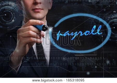 Business, Technology, Internet And Network Concept. Young Business Man Writing Word: Payroll