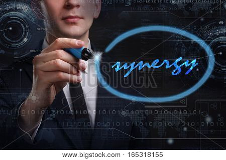 Business, Technology, Internet And Network Concept. Young Business Man Writing Word: Synergy