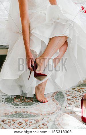 The bride wears wedding shoes. Women fashion
