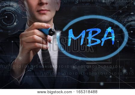 Business, Technology, Internet And Network Concept. Young Business Man Writing Word: Mba