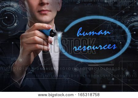 Business, Technology, Internet And Network Concept. Young Business Man Writing Word: Human Resources