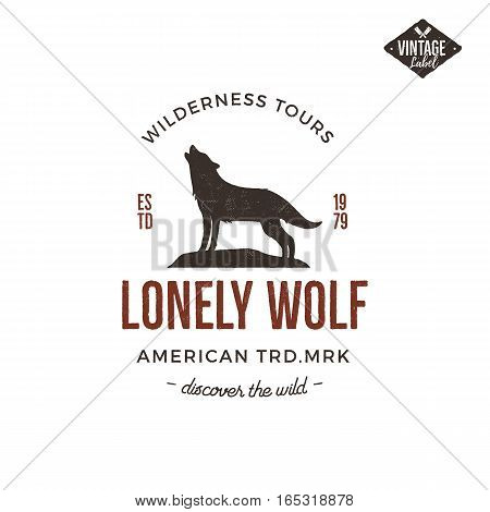 Old style wilderness label with wolf and typography elements. Vintage letterpress effect print.Prints of howling wolf. Unique design for t-shirts, mugs. Hand drawn wolf insignia, rustic design Vector