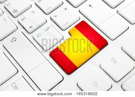 Spanish language or spain web concept. National flag enter button or key on white keyboard