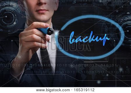 Business, Technology, Internet And Network Concept. Young Business Man Writing Word: Backup