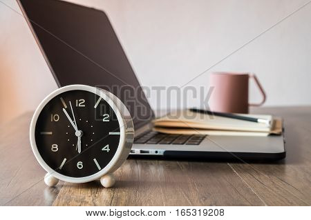 Working desk, Office and home office concept. with Laptop, Pencil, Clock, Milk cup on wooden table.