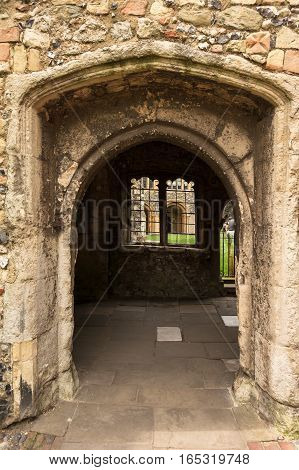 Arched walkway in the Precincts of Canterbury Cathedral. Canterbury Kent England