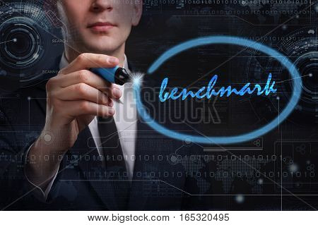 Business, Technology, Internet And Network Concept. Young Business Man Writing Word: Benchmark