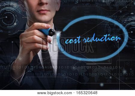 Business, Technology, Internet And Network Concept. Young Business Man Writing Word: Cost Reduction