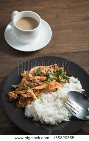 Thai food, Spicy fried chicken salad served with jasmine rice on dish.