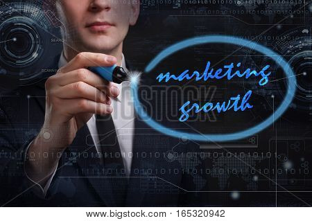 Business, Technology, Internet And Network Concept. Young Business Man Writing Word: Marketing Growt