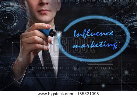 Business, Technology, Internet And Network Concept. Young Business Man Writing Word: Influence Marke