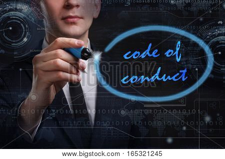 Business, Technology, Internet And Network Concept. Young Business Man Writing Word: Code Of Conduct