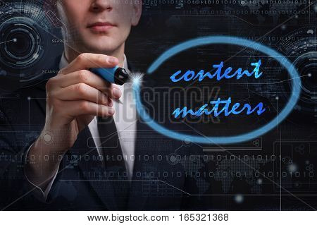 Business, Technology, Internet And Network Concept. Young Business Man Writing Word: Content Matters
