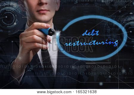 Business, Technology, Internet And Network Concept. Young Business Man Writing Word: Debt Restructur
