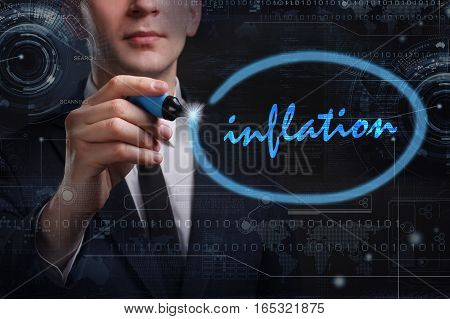 Business, Technology, Internet And Network Concept. Young Business Man Writing Word: Inflation